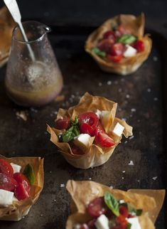 Caprese salad in phyllo baskets with an olive tapenade vinaigrette DrizzleandDip.com by Samantha Linsell