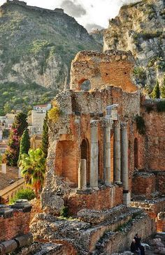 Greek Theatre with view on the Saracen castle in Taormina