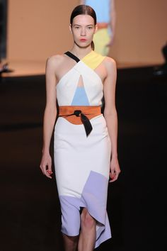 Designerrolandmouretpresented a desirable and feminine collection with sculpted silhouettes in colour blocked pastels , cinched at the waist with tie belts. #PFW #SS15