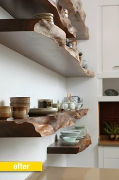 """Love these shelves! These raw edge wood shelves were constructed from a gorgeous and very old piece of wood that had been sitting in the Long Island studio of shoji screen and Japanese-inspired furniture maker Mr. Hanafusa, of Miya Shoji. Very striking! Each wood shelf weighs 300 pounds, and is held together by 200 eight-inch metal pins pushed through the existing wall."""
