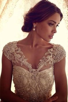 elegant  wedding dress.  Stones are really pretty.  I would just be cautious having stones under where your arms touch the dress cause that could be really annoying.