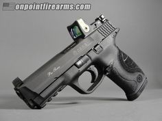 S&W Pro Series M&P 9mm C.O.R.E with Trijicon RMR. Loading that magazine is a pain! Get your Magazine speedloader today! http://www.amazon.com/shops/raeind M&p 9mm, Revolvers, Revolver Rifle, Military Guns, Smith Wesson, Assault Rifle, Concealed Carry, Guns And Ammo, Shotgun