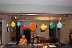 """I love the idea of making a hanging solar system in our """"classroom"""" (we are homeschooling our two younger ones for preschool) Probably would use styrofoam balls instead of balloons so they will last."""