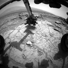 The percussion drill in the turret of tools at the end of the robotic arm of NASA's Mars rover Curiosity has been positioned in contact with the rock surface in this image from the rover's front Hazard-Avoidance Camera (Hazcam).  The drill was positioned for pre-load testing, and the Hazcam recorded this image during the 170th Martian day, or sol, of Curiosity's work on Mars (Jan. 27, 2013).