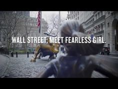 """The Fearless Girl"" Takes on the ""Charging Bull"" in NYC"