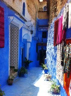 Bright blue alley or walking street in Chefchaouen Morocco!  Photo by my big sis DS! http://cococozy.com