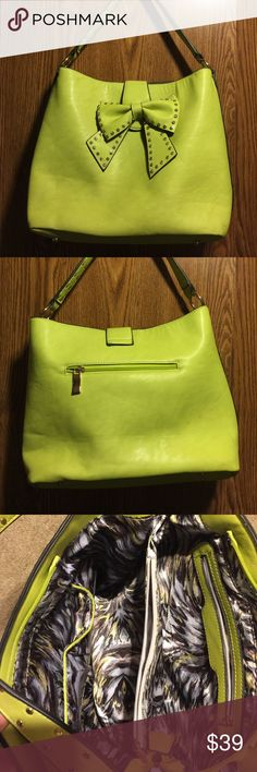 """CHARTREUSE shoulder bag with Bow accent Bright and fabulous this bag is beautiful! Chartreuse green with rhinestone accents, makes for a great holiday purse and goes well with all other seasons. Large pockets with middle divider and several smaller pockets for organizing! Approx 12""""x15 Bags Shoulder Bags"""