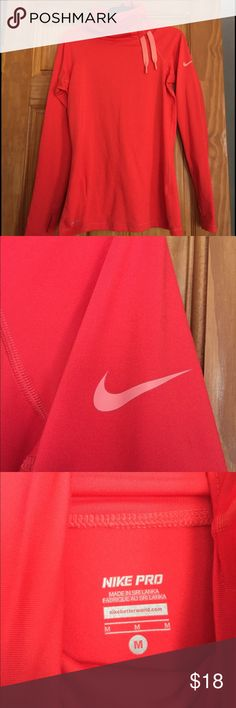 Nike Pro Running Pullover Very soft and stretchy Nike Pro Running Pullover. It is a coral color and very warm. Perfect running and being outside in cold weather! Nike Other
