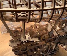Puzzle en bois 3D Maquette DIY Puzzle mecanique Mecapuzzle DIY  Loisirs créatifs Idée cadeau Puzzle Spaceship, Puzzle, Chandelier, Ceiling Lights, 3d, Lighting, Ideas, Home Decor, Creative Crafts