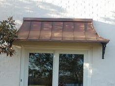 Wanting to install a bronze/copper roof over the front bay window. Copper Awning, Metal Awning, Copper Roof, Metal Roof, Copper House, Garage Door Design, Front Door Design, Front Door Colors, Garage Doors