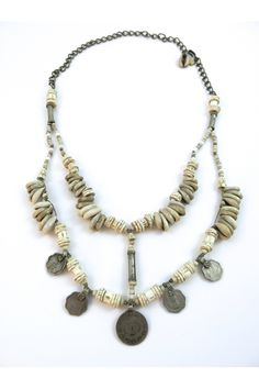 'The Women of White River' is one of our limited edition neckpieces handcrafted in our Byron Bay studio. With only 3 created, this stunning piece tells a beautiful story both visually and historically.   Featuring: • Old silver-alloy coin pendants and cylinder beads from the nomadic Banjara Tribe of Northern India. • Old ostrich eggshell disk beads from Kenya. • Fish vertebrae trade beads from Gambia. • Cowry shells from East Timor. • Miniature glass beading on knotted hemp with a brass…