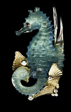Aquamarine carved seahorse by German carver  Michael Peuster set in 18 karat gold and diamonds.