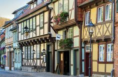 Quedlinburg, Germany - North of Germany's Harz Mountains, a castle rests high up on a hilltop and half-timbered houses trimmed with flower-stuffed window boxes hug narrow lanes.