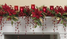 Berries, poinsettias, holly and electric candles in red glasses...perfect mantle or window sill