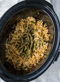 This Crock Pot Green Bean Casserole recipe is a perfect side dish for Thanksgiving or Christmas when the oven is full.