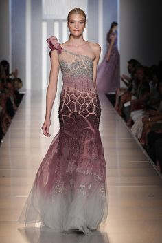 TONY WARD - One shoulder evening dress made of skin-colored Tulle Couture with a subtle play between transparencies and embroideries.