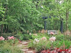 With astilbe, ferns and heuchera in front, and woods as a soothing surround, who wouldn't want to venture up this flagstone path to a comfortable swing?  http://www.hgtv.com/landscaping/outdoor-rooms-we-love-from-rate-my-space/pictures/page-7.html?soc=pinterest