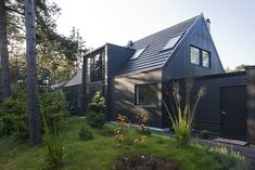Sweet Scandinavian Casa. Love the dark gray exterior, skylight windows, big windows, natural landscaping, Very simple shapes.