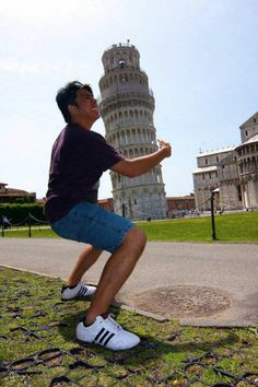this is a picture of forced prospective because this guy is acting like he is hugging the leaning tower of pisa