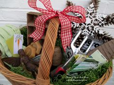 DIY ~ Gifts For the Gardener~A natural woven basket filled with peat pots & trays, potting soil, heirloom vegetable seeds, twine, gloves, trowel, hose sprinkler head, cast iron garden accent . . . .