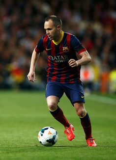 Andres Iniesta of Barcelona in action during the La Liga match between Real Madrid CF and FC Barcelona at the Bernabeu on March 23, 2014 in Madrid, Spain.