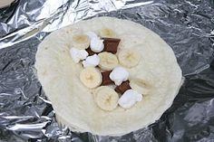 Banana boat tortillas--great idea for camping.  Put bananas, marshmallows, and chocolate in a large tortilla. Roast over a campfire for 5 minutes in foil.