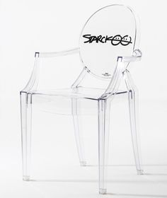 """10th anniversary edition of """"louis ghost chair"""" with Starck's signature. Since its inception in 2002, the seat has sold 1.5 million pieces, making it the most widely sold 'original design' chair in the world.  