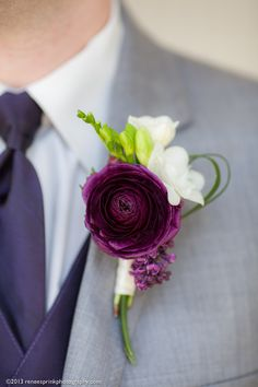 Flawless purple ranunculus bloom makes for a perfect boutonniere when paired with white freesia and a touch of foliage. Photo by Renee Sprink; design by English Garden @raleighflorist