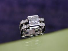 This ring is very modern!  The center stone is a Princess cut!  The shank is square and so is the top!