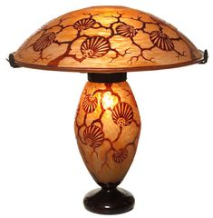 """Exceptional Le Verre Francais lamp, Ginko leaf decoration in red against mottled yellow ground, glass base and shade supported by a three arm wrought iron fixture, 20""""dia. shade and base with etched signature, both shade and base illuminate, overall height 20"""", fixture with its original patina, extremely decorative with elaborate workmanship"""