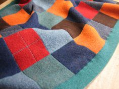 Recycled wool sweater blanket.  Love the use of color