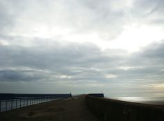 The dam stretches down into the sea---photographed in Swansea
