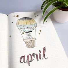 Bullet journal monthly cover page, April cover page, hand lettering, cute bunny in a hot air balloon drawing. | @shemeetspaper