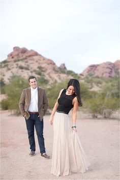Elegant Desert Engagement Session, Cream Chiffon paired with Black silk, Perfect wardrobe Inspiration for your Engagement Session, Engagement Outfits, Maxi Skirt, Full length dress, Flowy Chiffon, Luxurious Desert theme.