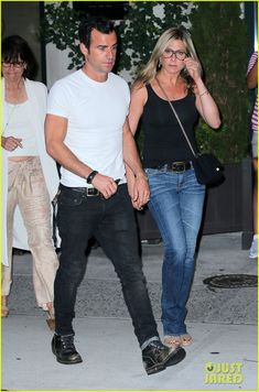 Jennifer Aniston and Justin Theroux head out of their apartment building to go to dinner on Saturday evening (July 20) in New York City.
