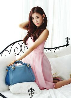 Tiffany is a beauty in vibrant and pastel colors in the handbag and wallet lookbook for 'Jill Stuart'   allkpop.com