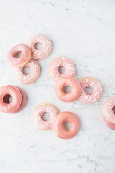 baked doughnuts with  pink almond glaze