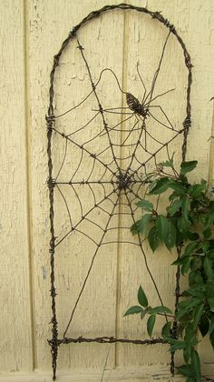 Spinning Spider In A Web Barbed Wire Garden Trellis Spinning Spider In A Web Stacheldraht Garden Tre Diy Garden, Garden Trellis, Garden Crafts, Barbed Wire Art, Barbed Wire Wreath, Rooftop Garden, Unique Gardens, 3d Max, Wire Crafts
