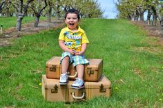 Boy's 2nd birthday photo shoot in the orchard. spongebob, vintage suitcase, real smile