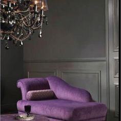 Dark Grey Walls and purple chair...