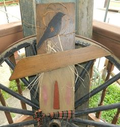 PRIMITIVE HANGING SCARECROW WITH CROW