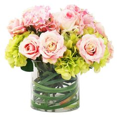 Create a lush tablescape or charming vignette with this lovely faux hydrangea and rose arrangement, nestled in a glass vase for classic appeal.