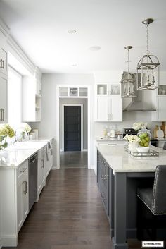 Gorgeous white and grey kitchen with brushed silver accents and hardware. #whitekitchen #kitchenideas #kitcheninspiration #kitchendecorating #kitchenisland