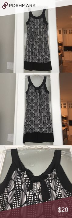 Black and white geometric patterned dress Sheath dress with geometric patter and black trim. Fun and flirty for any night out. Ties in back. Dresses Midi