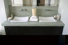 this sink with bubble tiles behind on accent wall and wall mount faucet and frosted glass counter