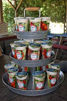 Cute way to fix and display veggies in a cup with ranch for an outdoor party!