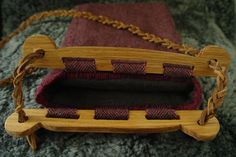 The 'Haithabu bag' or the 'Hedeby bag' is a bag consisting of a fabric or leather pouch attached to two wooden handles. The modern name derives from the trading settlement in Schleswig-Holsteinkno…