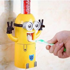 Toothpaste Dispenser Minion Toothpaste Dispenser Minion themed automatic kids toothpaste dispenser to make brushing teeth interesting and fun fo. Minion Bedroom, Bathroom Accessories, Home Accessories, Minion Stickers, Casa Disney, Kids Toothpaste, Cute Minions, Minion Stuff, Evil Minions