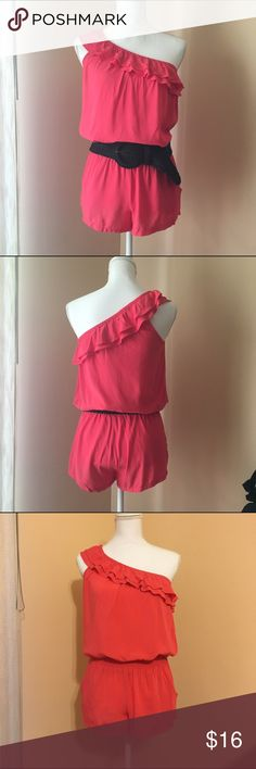 Bebe Coral One-Shoulder Romper- S One-Shoulder shorts romper with thick elastic waistband and ruffles along neckline. Shown belted, but belt is not included. Coral/pink color. Rayon. bebe Other