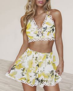 The Lemonade In The Shade Crop Top is a sweet as a Sunday picnic! Featuring a bold and bright lemon print on silky chiffon. Crochet trim detail and strappy back for the ultimate fit. Padded bust. Pair with the Lemonade In The Shade Shorts to complete the set!